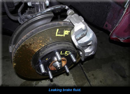 Leaking brake fluid.